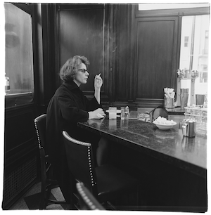 """Woman at the counter smoking, N.Y.C.""/ Diane Arbus"